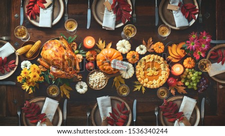 autumn or fall table place setting decorated with autumnal leaves stock photo © illia