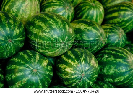 Large group of big green watermelons in supermarket making heap Stock photo © pressmaster