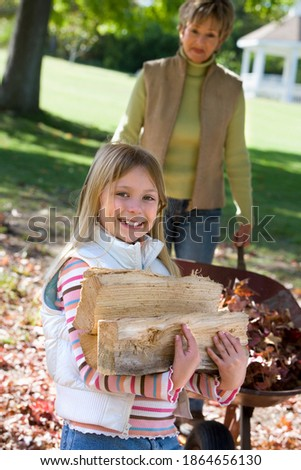 Stock photo: Front view of a grandmother helping her granddaughter with homework in living room at home