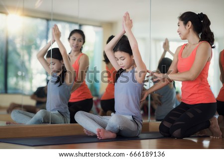 Young female yoga teacher teaching yoga to school kids in school Stock photo © wavebreak_media