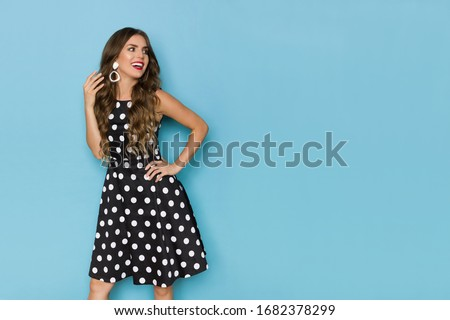 Smiling young woman in a polka dots dress talking on the retro p Stock photo © dashapetrenko