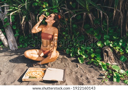 Stylish lady on vacation in swimwear chilling at sandy beach Stock photo © dash