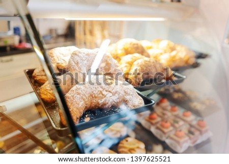 Confectioner shot through glass display in her shop Stock photo © Kzenon