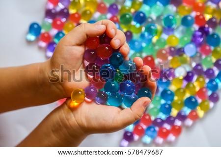 Színes golyók víz gyöngyök kezek érzékelési Stock fotó © galitskaya