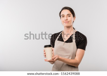 Pretty young waitress of cafe passing you disposable glass with hot coffee Stock photo © pressmaster