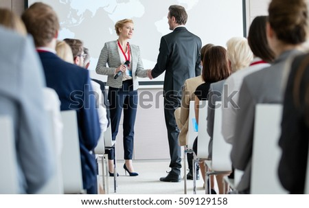 Rear view of diverse business people attending a business seminar in office building Stock photo © wavebreak_media