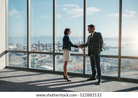 Front view of Caucasians business executives shaking hand while sitting on the sofa in modern office Stock photo © wavebreak_media