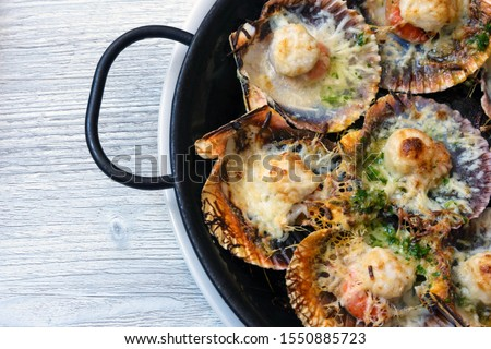 Baked scallops with cheese and spicy sauce. Delicate is a real p Stock photo © joannawnuk