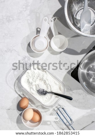 Making of mixing eggs in bowl on marble table as homemade food f Stock photo © Anneleven