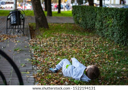 Child baby sitting on the ground without parents in the meadow Stock photo © ElenaBatkova