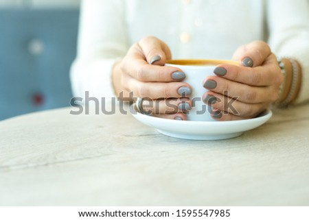 Hands of young restful woman in casualwear holding cup of coffee Stock photo © pressmaster