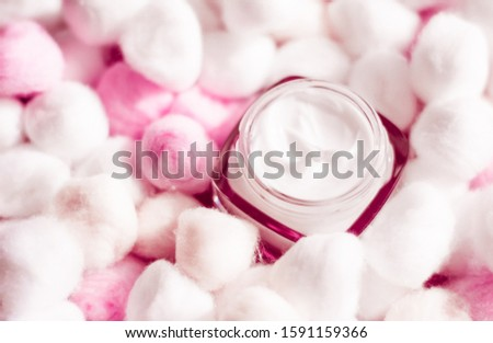 Luxury face cream for sensitive skin and pink cotton balls on ba Stock photo © Anneleven
