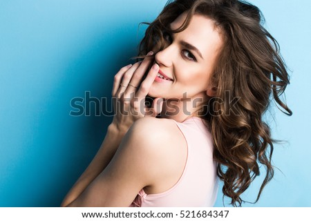 Attractive blue eyed brunette female looks with bewilderment at camera, has specific appearance, can Stock photo © vkstudio