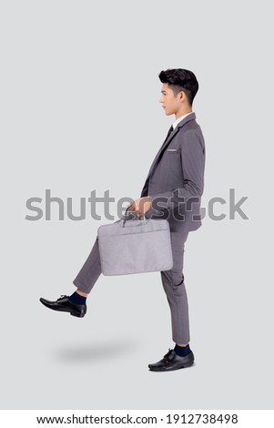 Elegant attractive male executive manager holds modern digital tablet, reads financial news on web p Stock photo © vkstudio