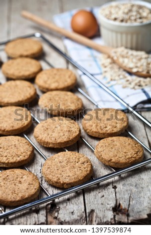 Baking grid with fresh oat cookies on rustic wooden table backgr Stock photo © marylooo