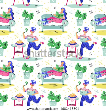 young smiling man with saucepan cooking and smiling girl with blue hair on the couch stock photo © foxbiz