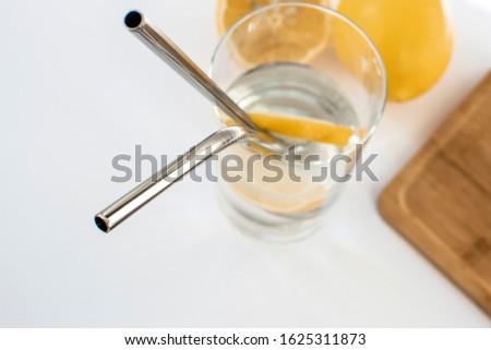 Steel drinking straws on a yellow background. Zero waste concept Stock photo © galitskaya