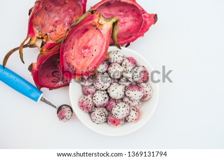 Pitahaya crafted in balls on white background. Sliced tropical fruit. Dessert serving. Carved fruit. Stock photo © vkstudio