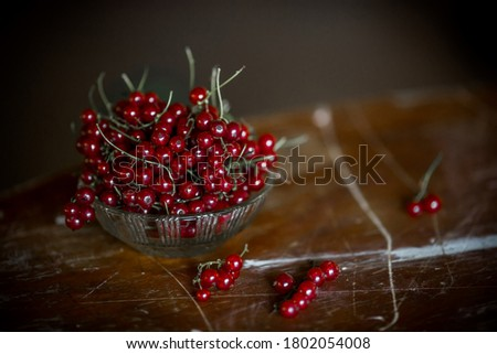 Tasty ripe red currant on plate at dark rustic table. Fresh summer berries. Fruit and vitamins. Heal Stock photo © vkstudio
