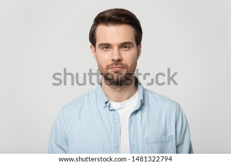 Serious concentrated unshaven male entrepreneur looks thoughfully in window of coffee shop, drinks t Stock photo © vkstudio