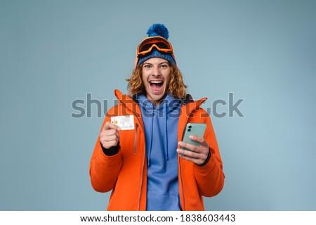 Kép fiatal sportoló mobiltelefon fülhallgató izolált Stock fotó © deandrobot