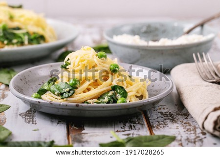 Tagliatelle pasta with creamy ricotta cheese sauce and asparagus served white ceramic plate Stock photo © dash