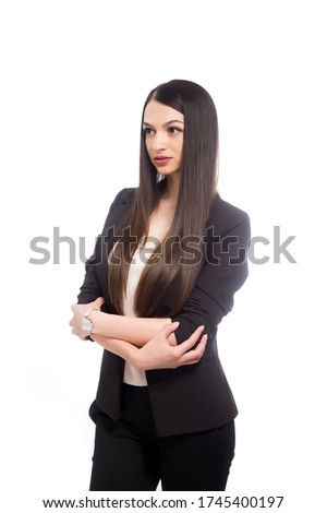 Isolated shot of pretty young European woman in black fashion dress, stands sideways, wears manicure Stock photo © vkstudio
