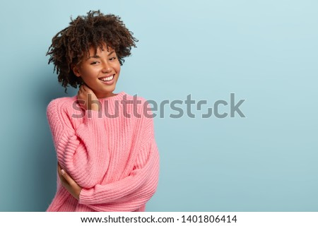 Isolated shot of charming glad young woman with pleasant smile, wears white turtleneck, looks direct Stock photo © vkstudio