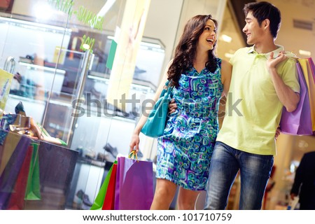 Two excited shopping woman together inside shopping mall. Horizo stock photo © HASLOO