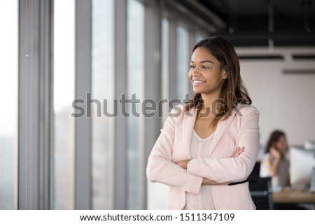 Stock photo: Happy business woman in the office resting and daydreaming. Clou