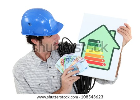 craftsman holding an energy consumption label and money in cash Stock photo © photography33