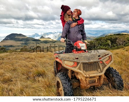 a couple doing bike in the country, the woman is doing airplane with her arms Stock photo © photography33