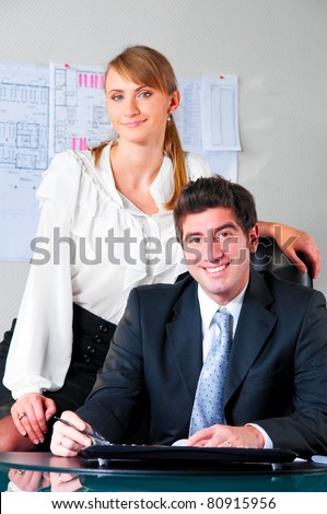 gorgeous brunet businesswoman and male colleagues in background Stock photo © photography33