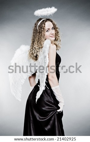 Portrait angel woman wearing angelic wings over white, outdoors Stock photo © Victoria_Andreas
