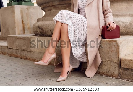 Beautiful slim girl in high heel shoes with a stylish red bag in Stock photo © RuslanOmega