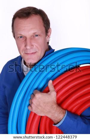 Eletricista azul vermelho plástico tubulação Foto stock © photography33