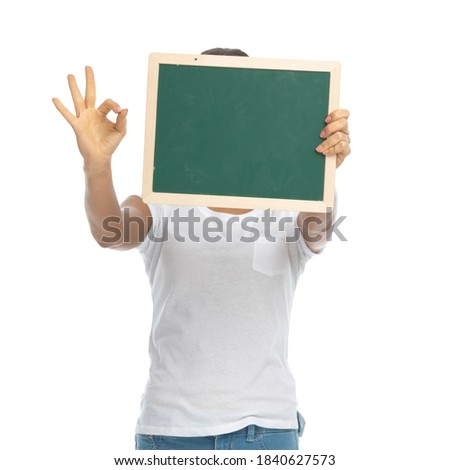 good looking woman hidding behind a board while standing against a white background stock photo © wavebreak_media