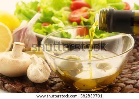 Friss zöldségek gombák olívaolaj bors shaker izolált Stock fotó © karandaev