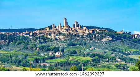 Stock photo: Medieval Stone Cuganensi Tower Ancient Buildings San Gimignano T