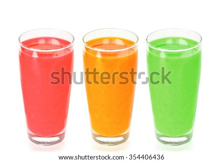 yellow green and red fruit and vegetable juices in tumbler glas stock photo © epstock