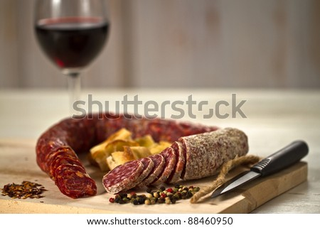 sausage with knife over cutting board stock photo © stoonn
