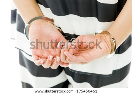 Midsection of a handcuffed Asian young woman in prisoners uniform Stock photo © bmonteny