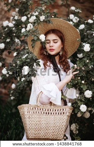 Stock photo: Beautiful young woman in Victorian style outfit and rose corset