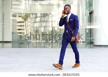 full length portrait of african man talking on the phone isolated on a white background stock photo © deandrobot