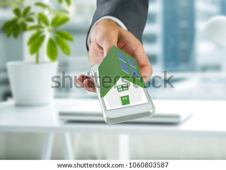 White house in hand with green roof of screen laptop. Background sun shines brightly on right Stock photo © cherezoff