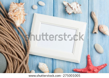 Sea vacation with blank photo frame, star fish and marine rope Stock photo © karandaev
