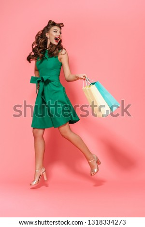 full length portrait of smiling surprised girl with retro hairstyle stock photo © deandrobot