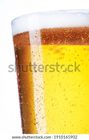 Fresh glass of pils beer with froth and condensed water pearls & Stock photo © kayros