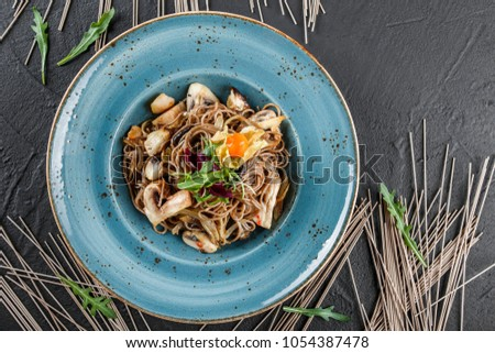 Tasty Soba noodles with vegetables in sweet and sour sauce on ol Stock photo © Yatsenko