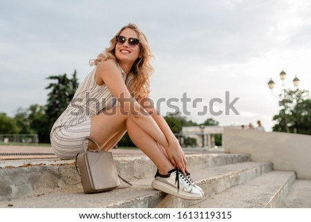 Beautiful blond young woman in fashion dress sitting in royal ar Stock photo © Victoria_Andreas